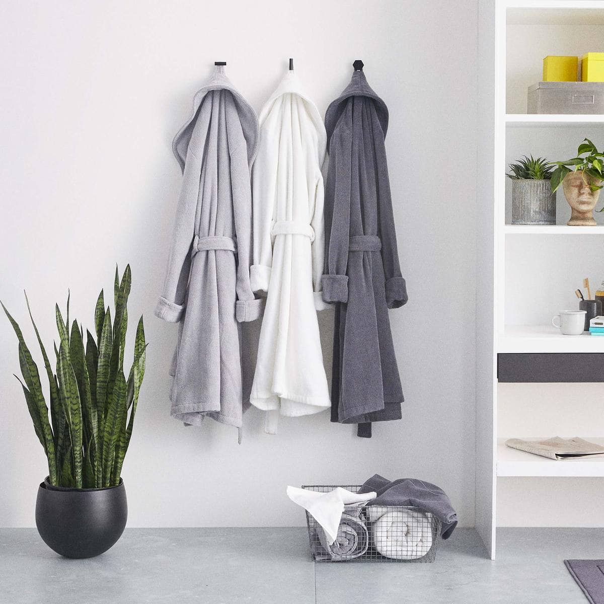 robes hanging on wall