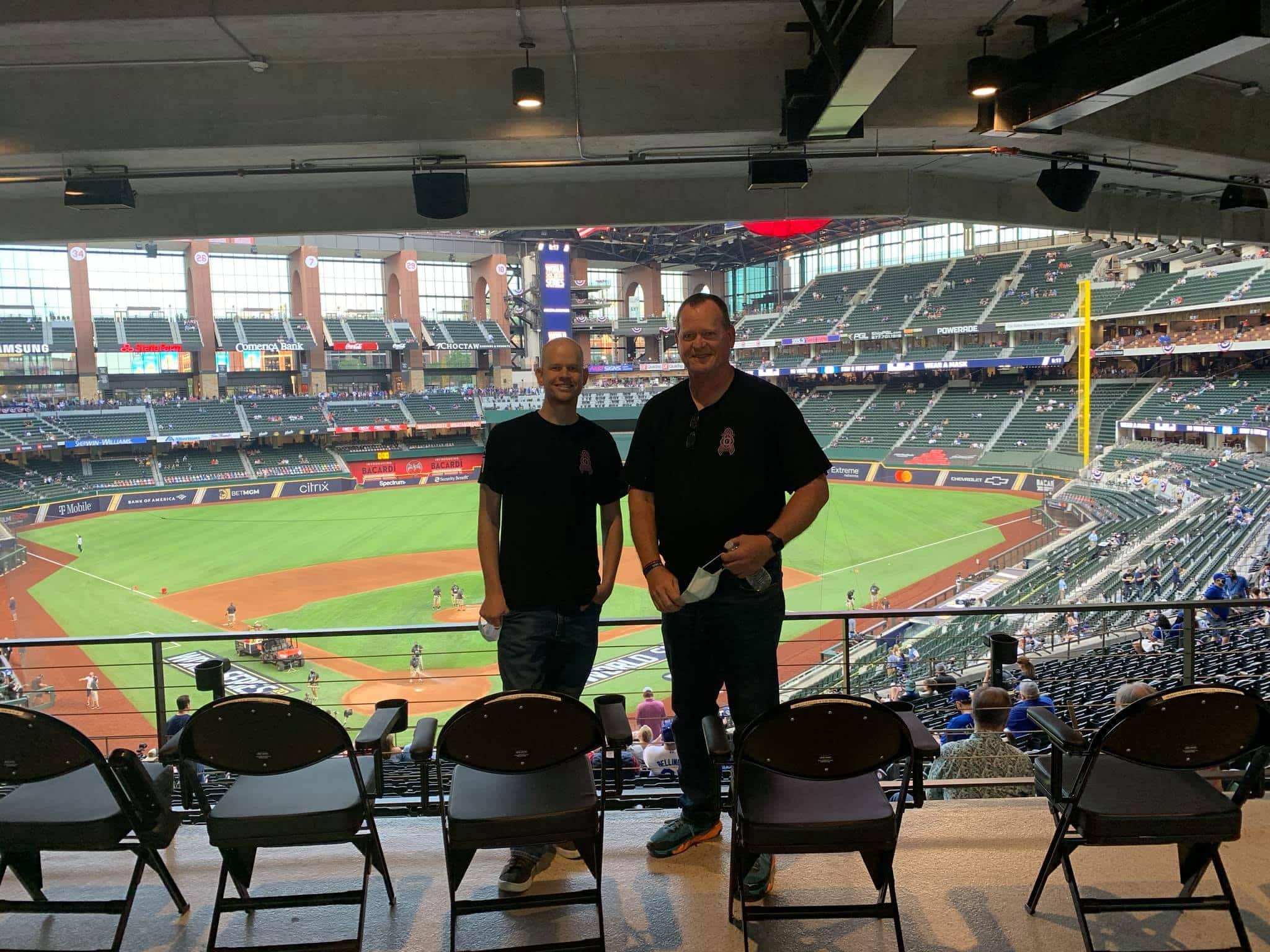 Brandon with Dad baseball stadium