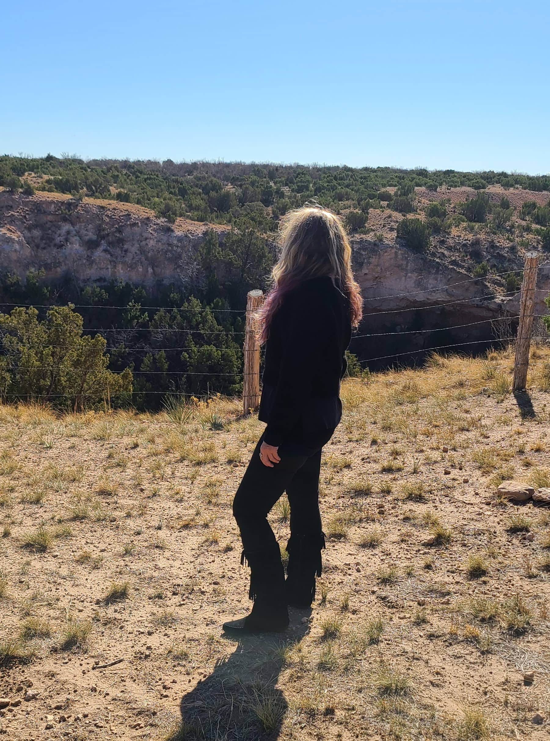 lady standing by canyon