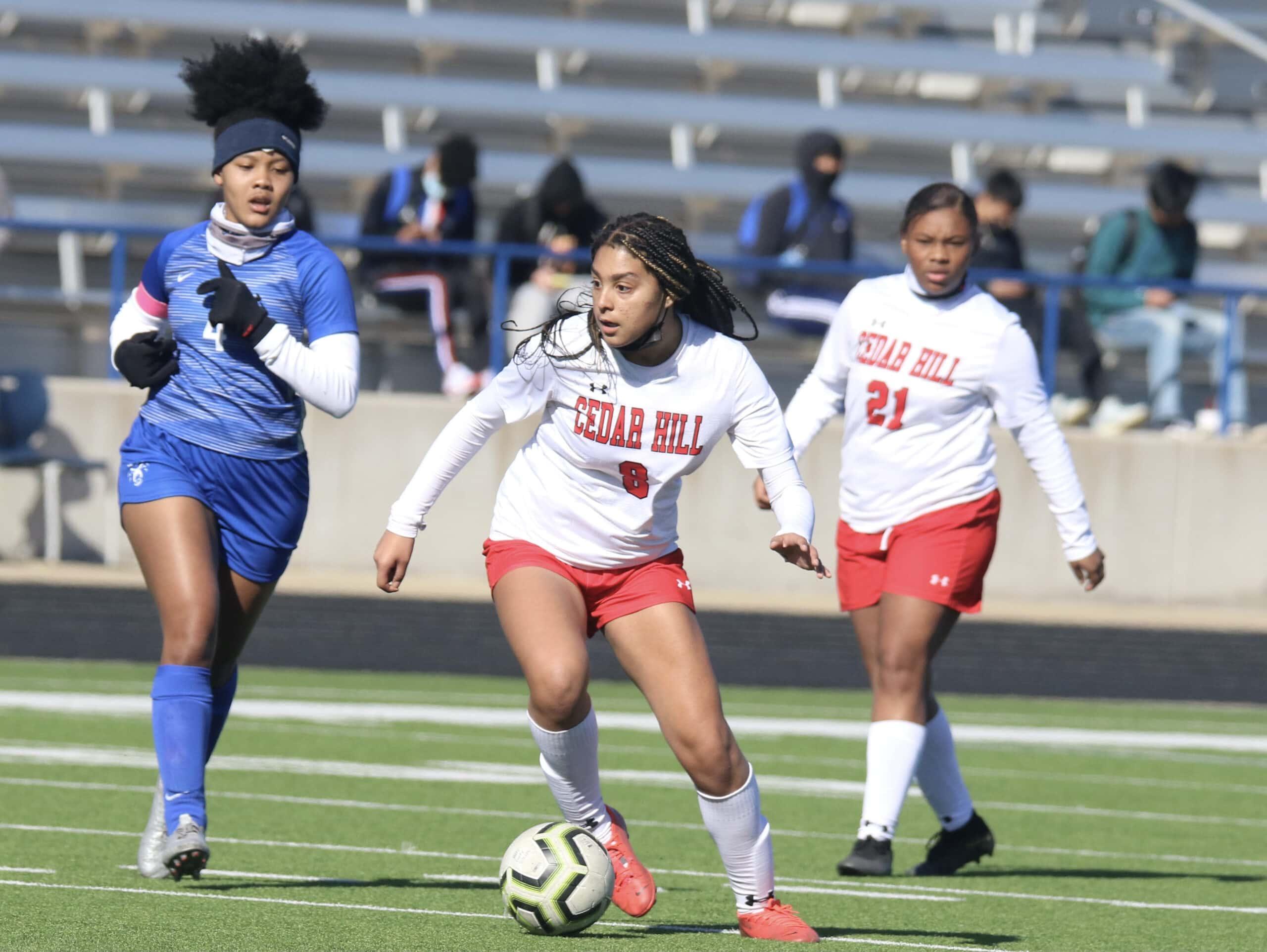 Kaylee Slider kicks soccer ball