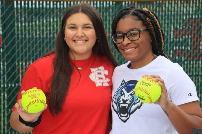 two girls with softballs