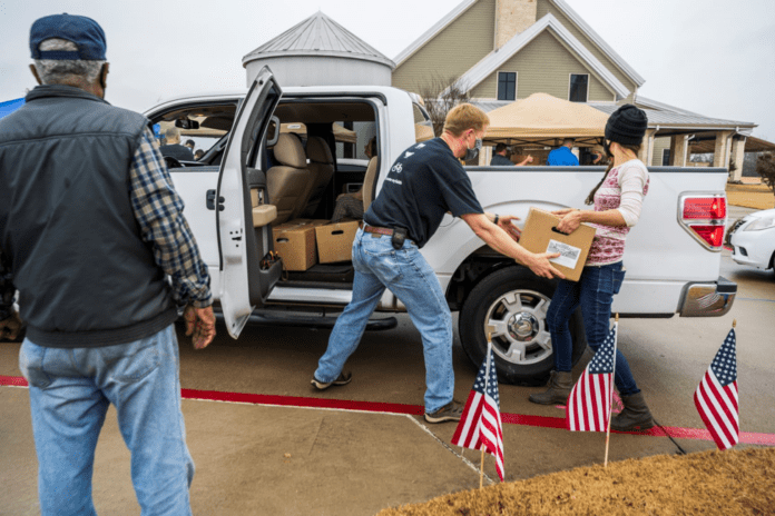 People loading boxes in truck