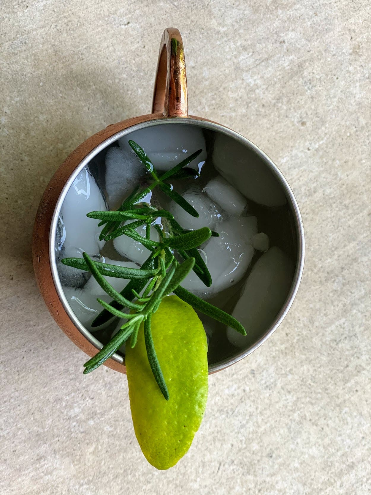 copper mug with ice and lime