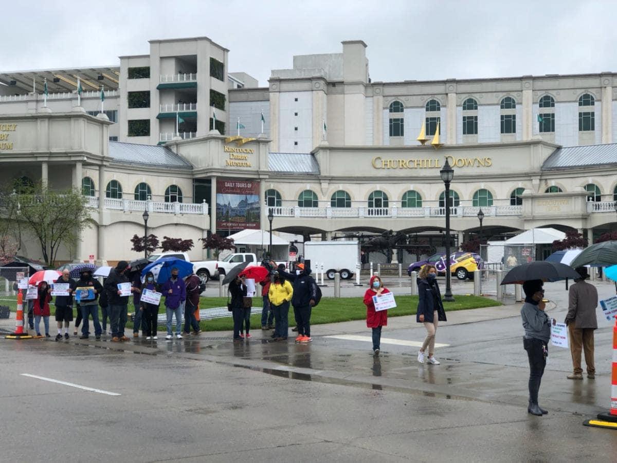 people protesting in rain