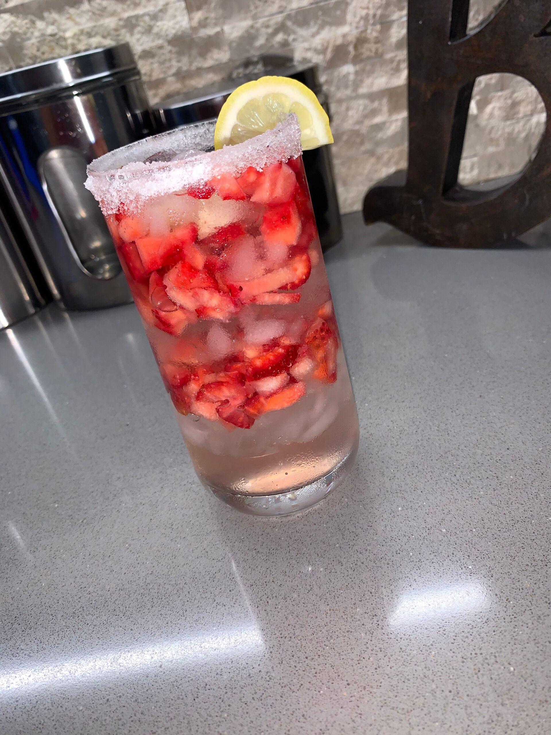 glass of water with lemon garnish
