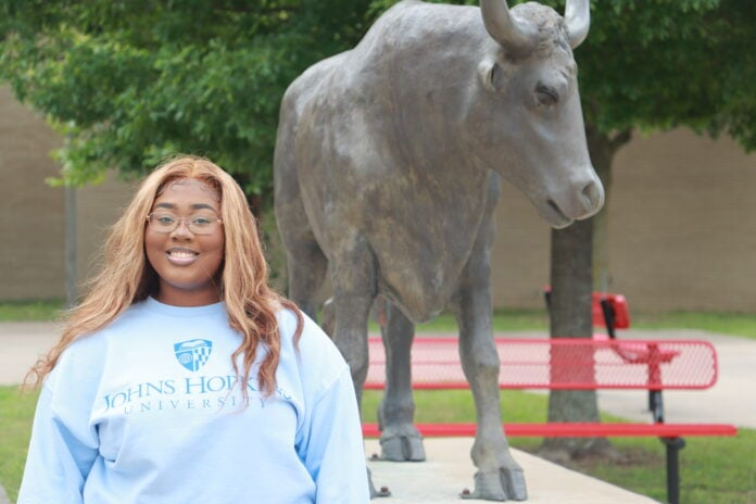Gia Henderson with Longhorn statue
