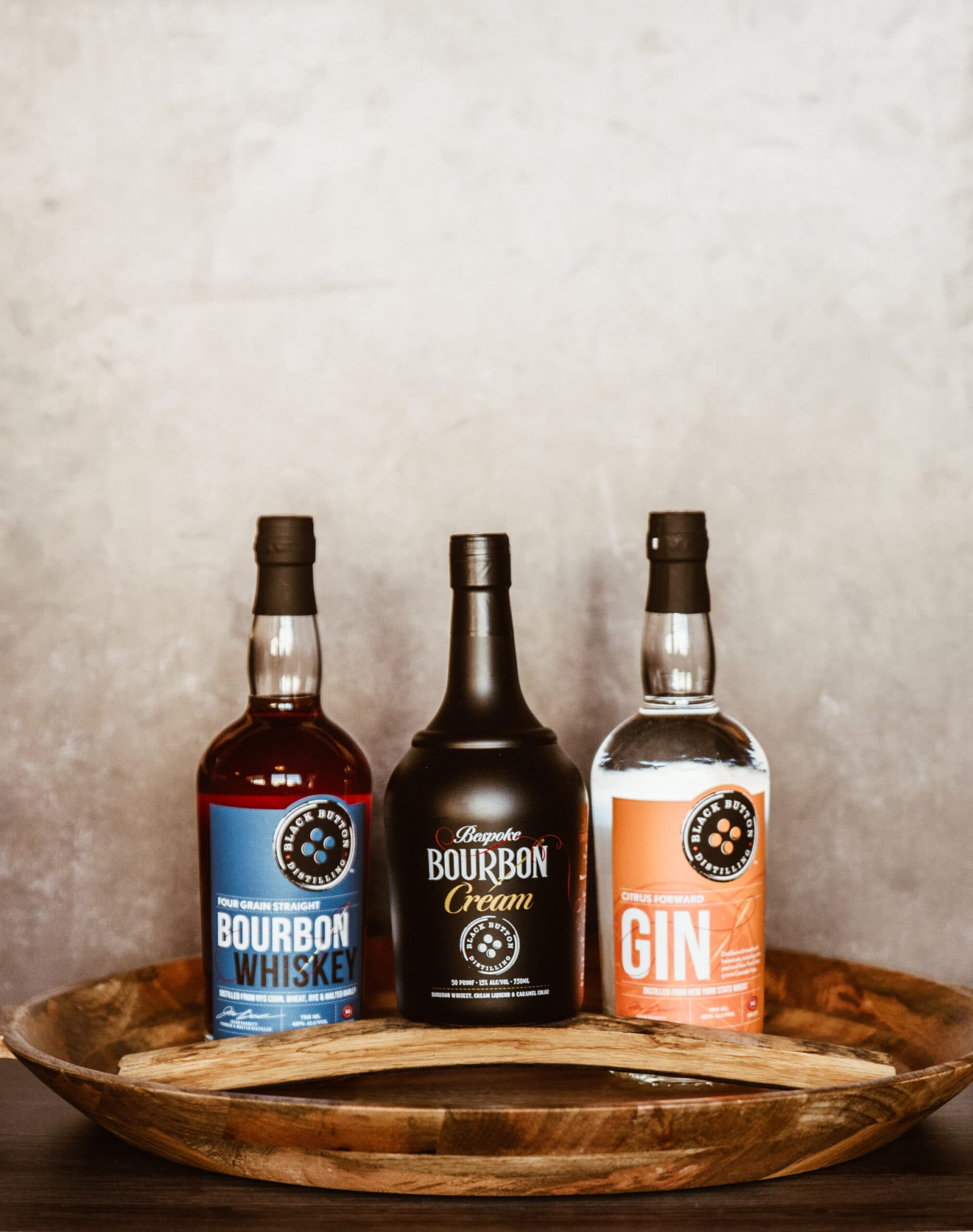 Black Button Bourbon Cream and Gin bottles