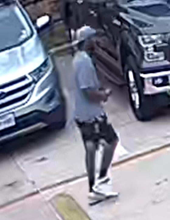 Black male standing in parking lot