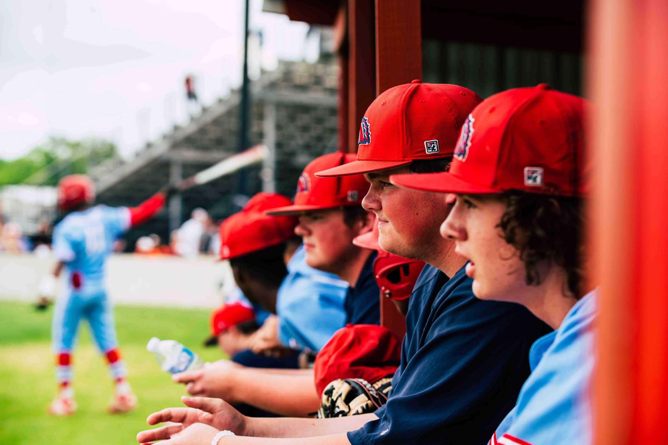 Baseball players watch game