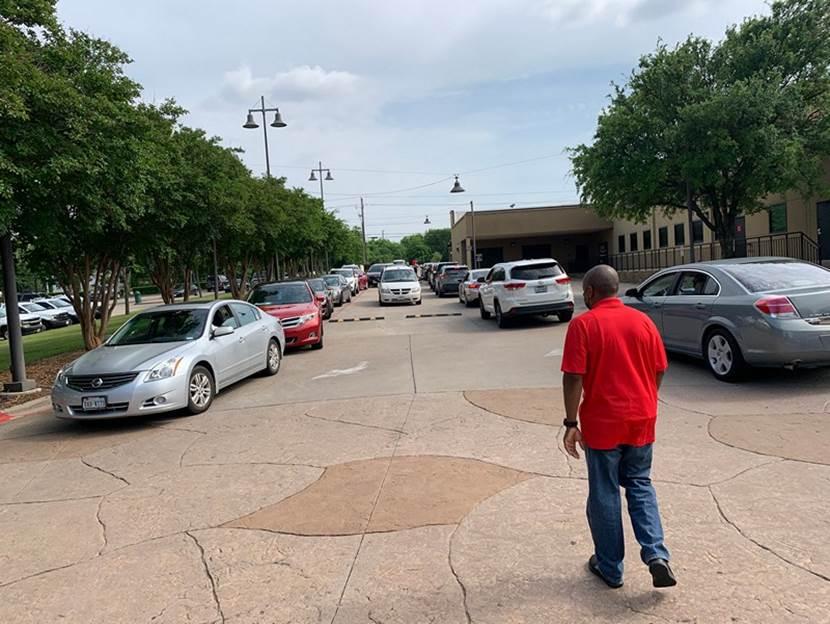 Man directs traffic at DeSoto City Hall