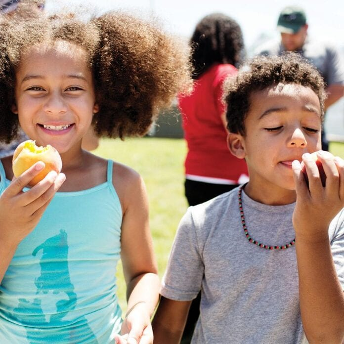 Kids eating peaches