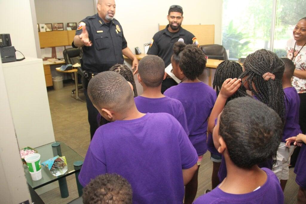 Robert D. Brown Jr. talks with students