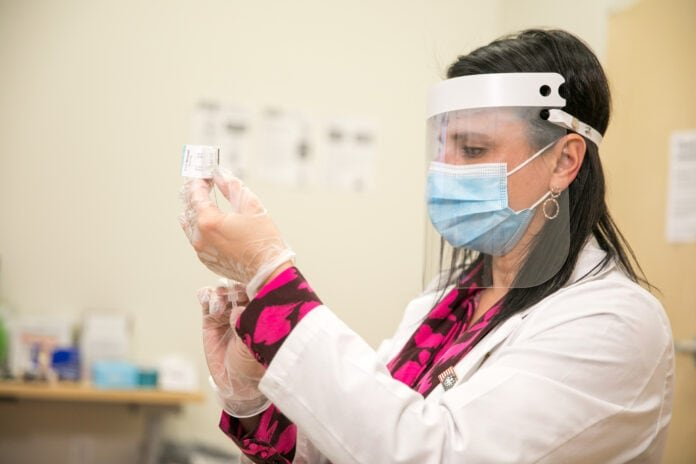 Pharmacist with face mask and face shield