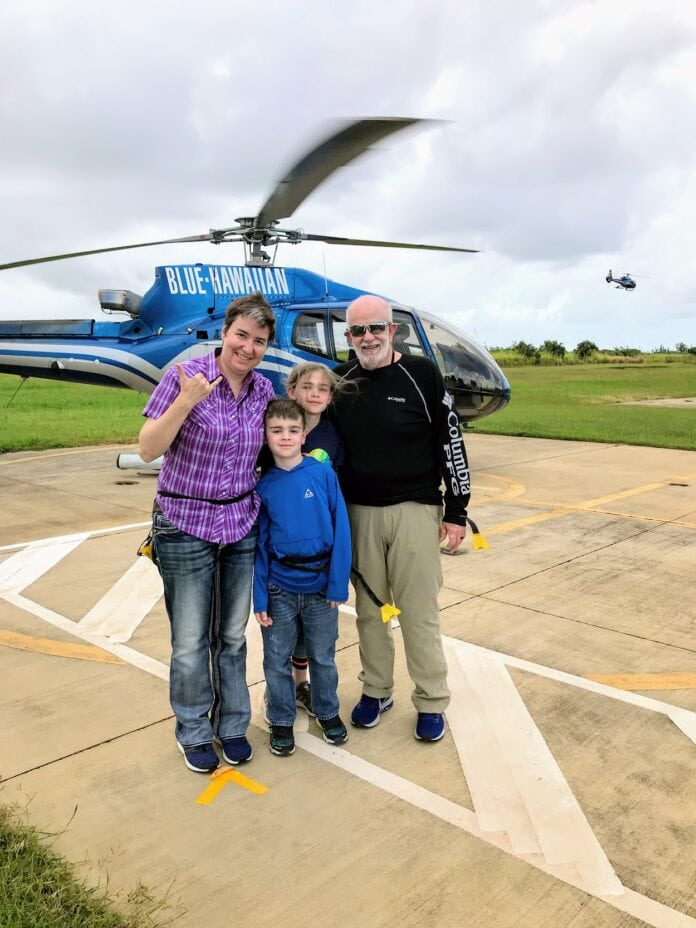 family standing in front of helicopter