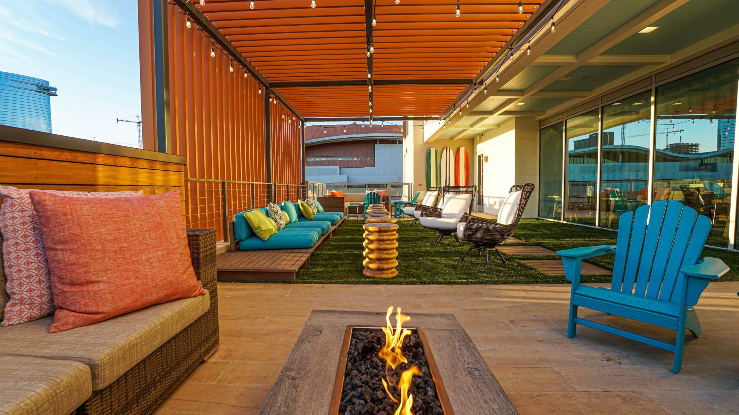 fire pit and couches on rooftop