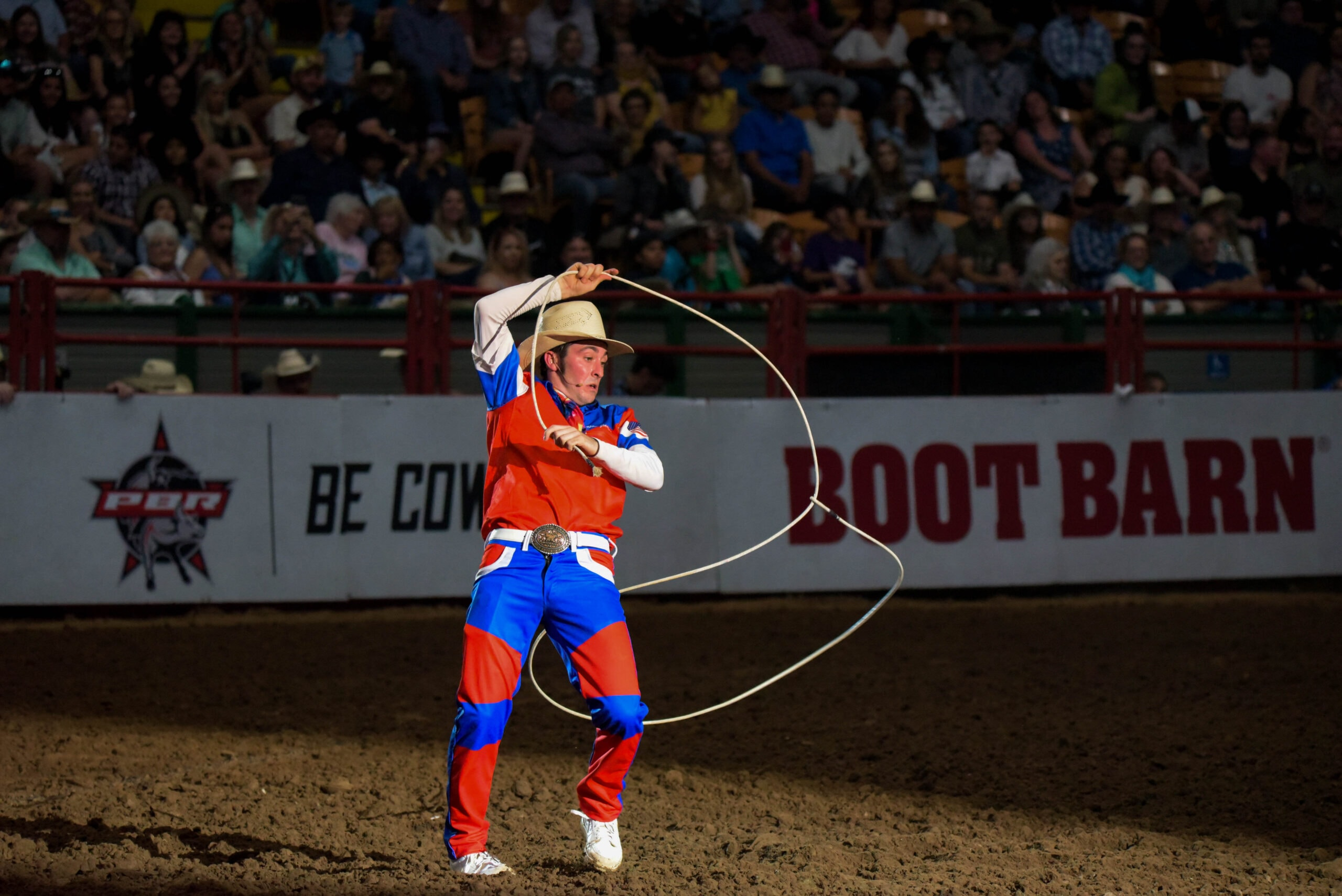 cowboy with lasso in arena