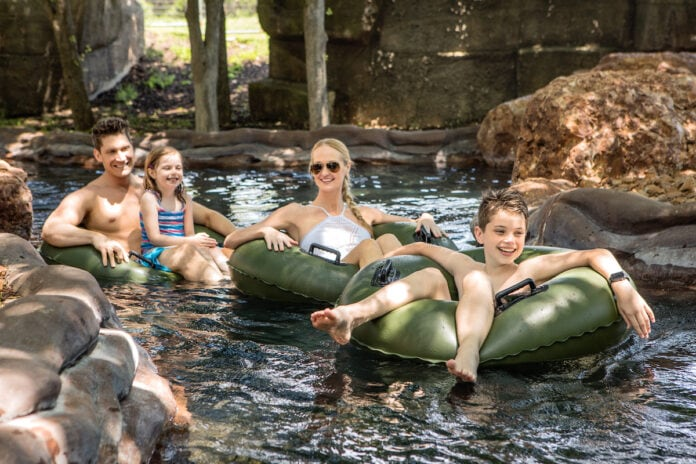 people in tubes in lazy river