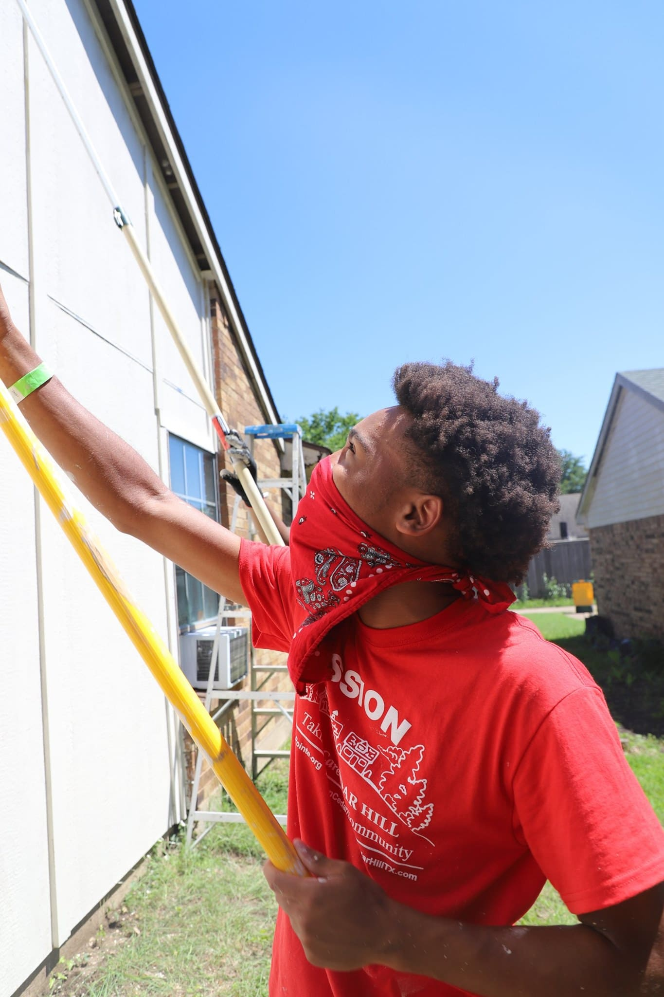 young man painting house