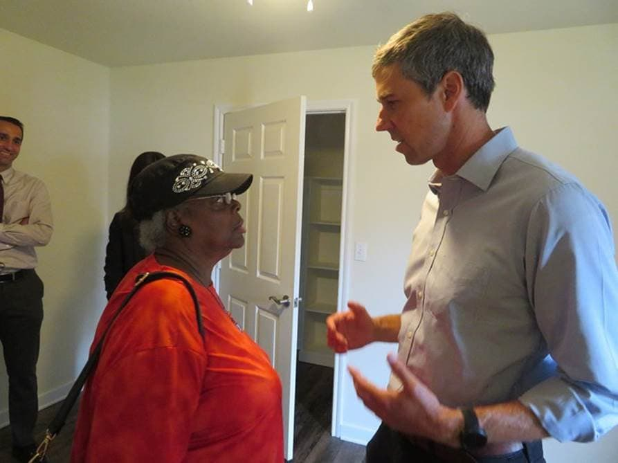 Beto speaks with lady in apartment