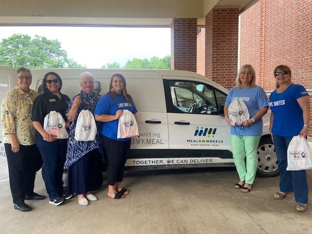 ladies standing in front of van