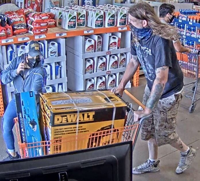 man with shopping cart of tools