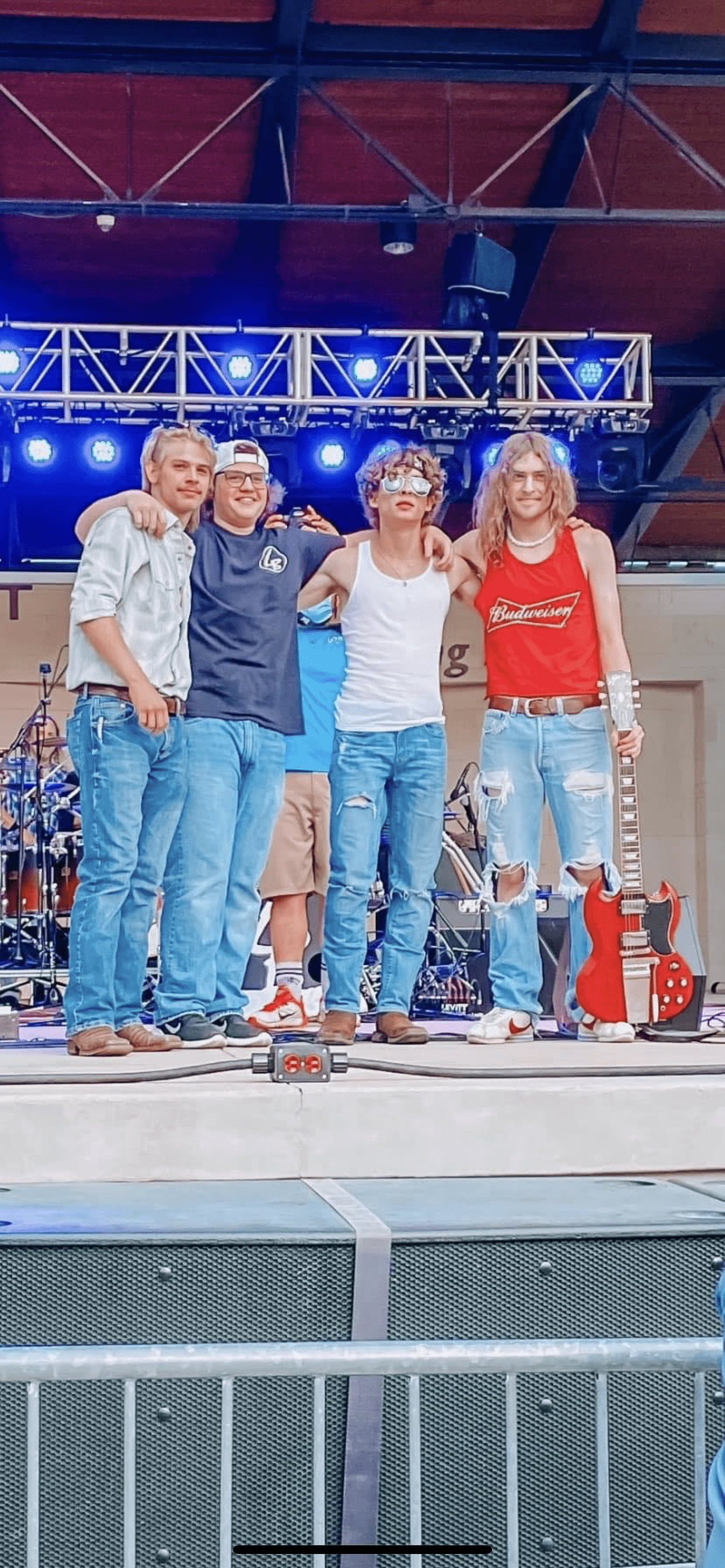 four guys standing together