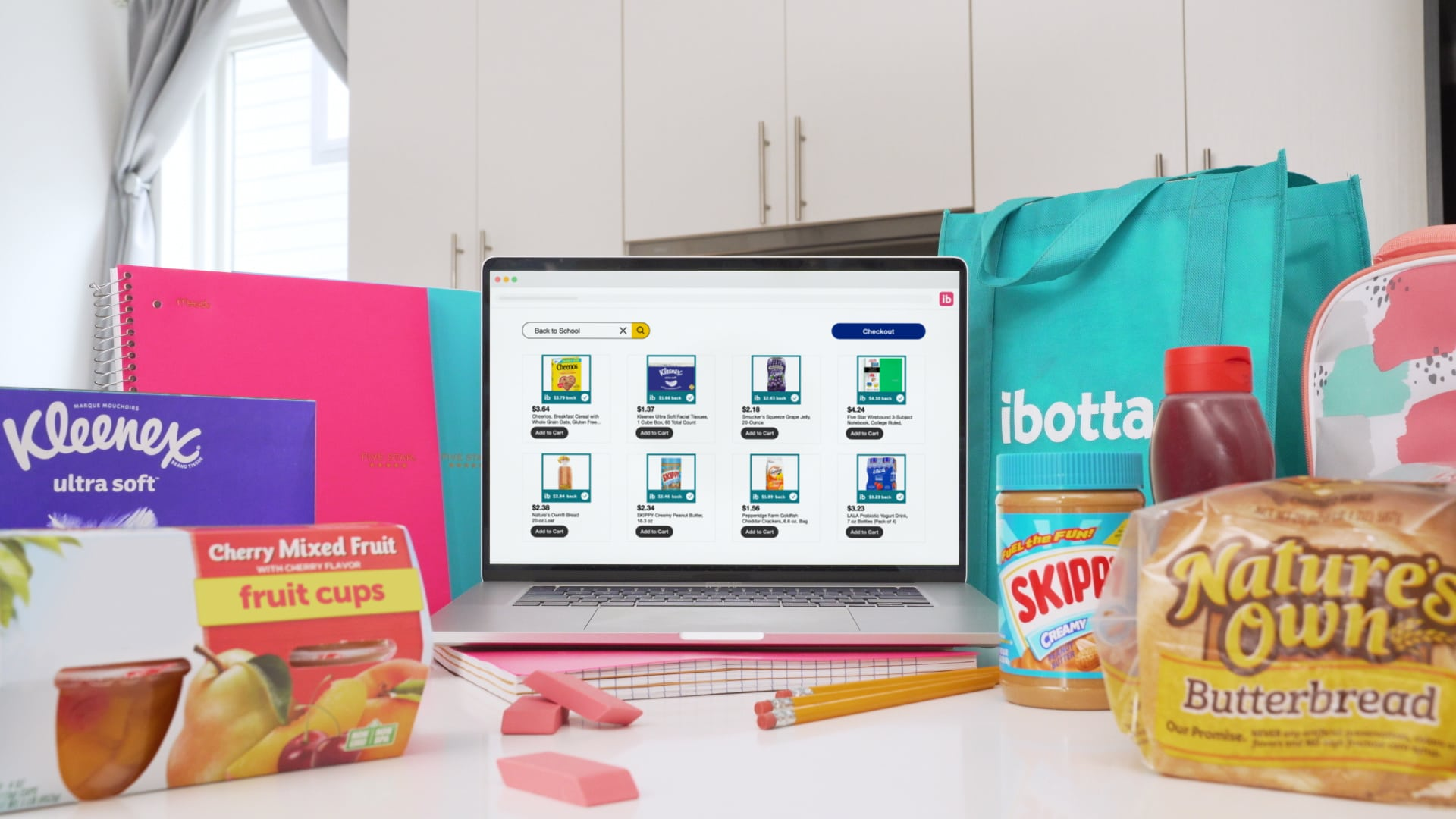 computer screen surrounded by food