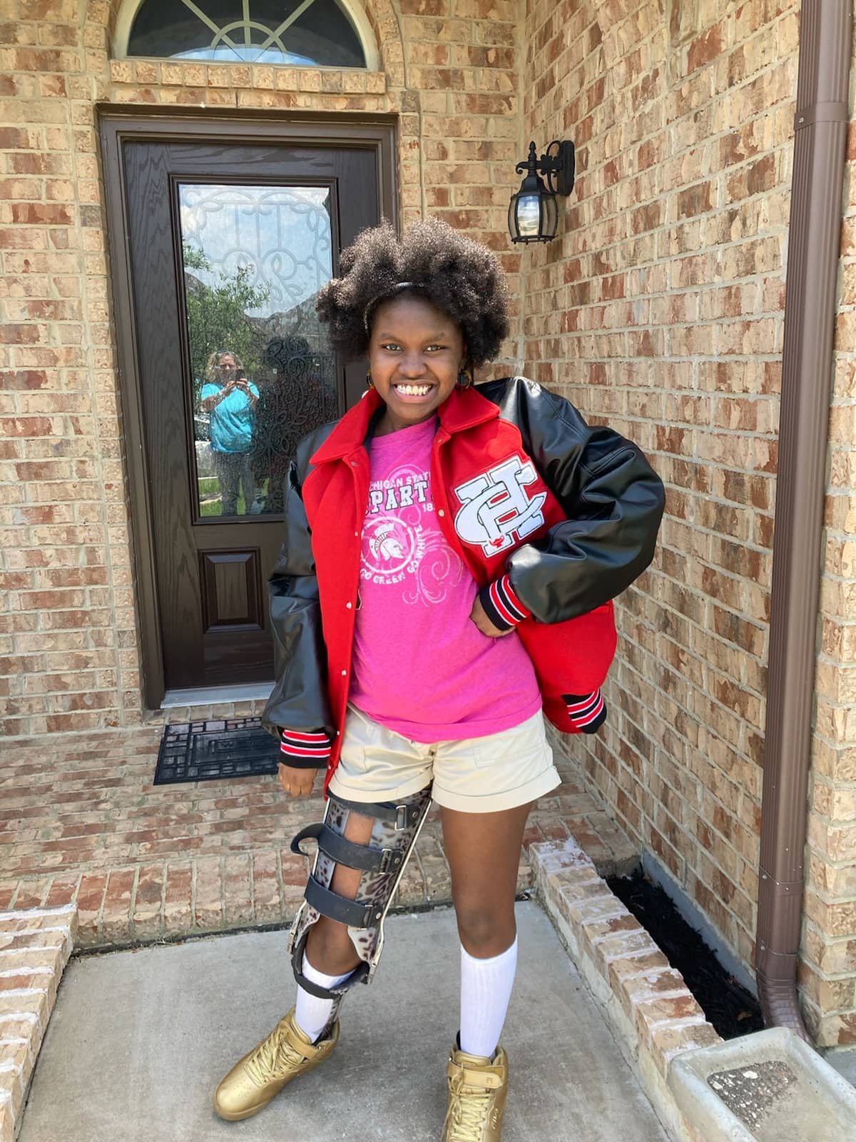 Timiyah Miles with letterman jacket