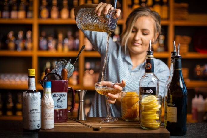 female bartended pouring drink