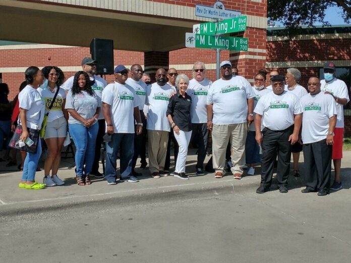 MLK Committee group in front of street sign