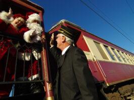 train conductor with Santa Claus