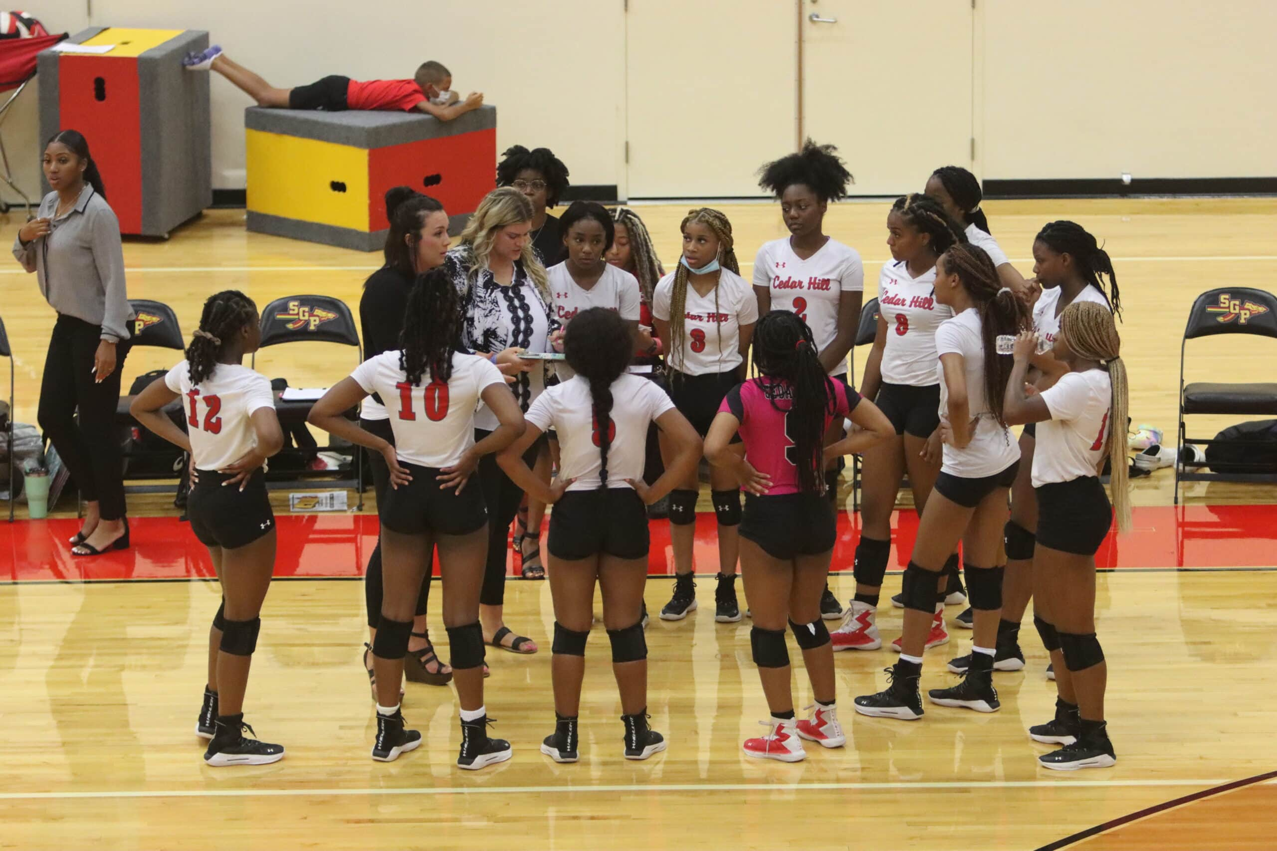 Cedar Hill volleyball team on sideline