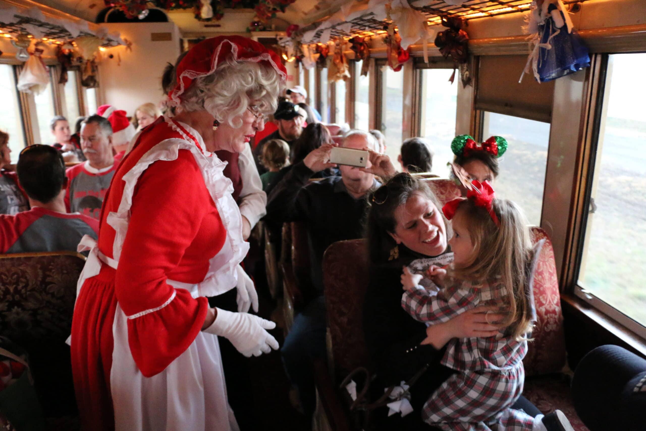 Mrs Claus greets children