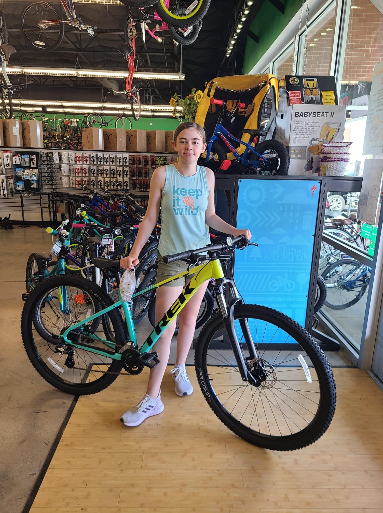 girl with Trek bike