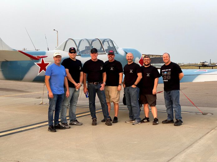 men standing in front of aircraft