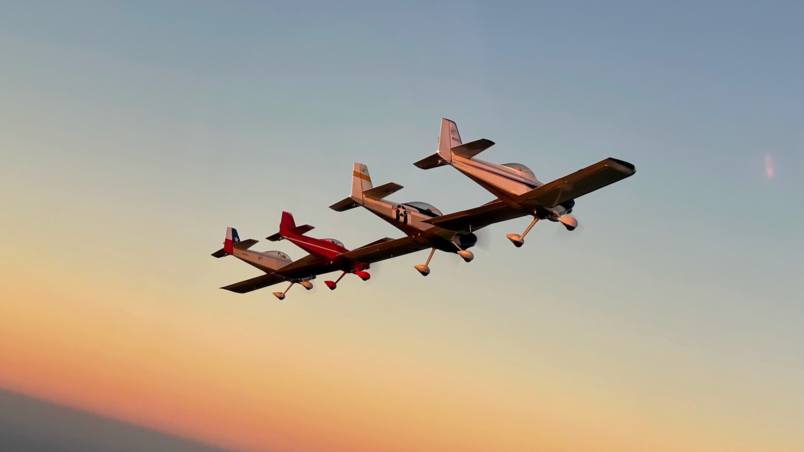 planes in formation at sunset