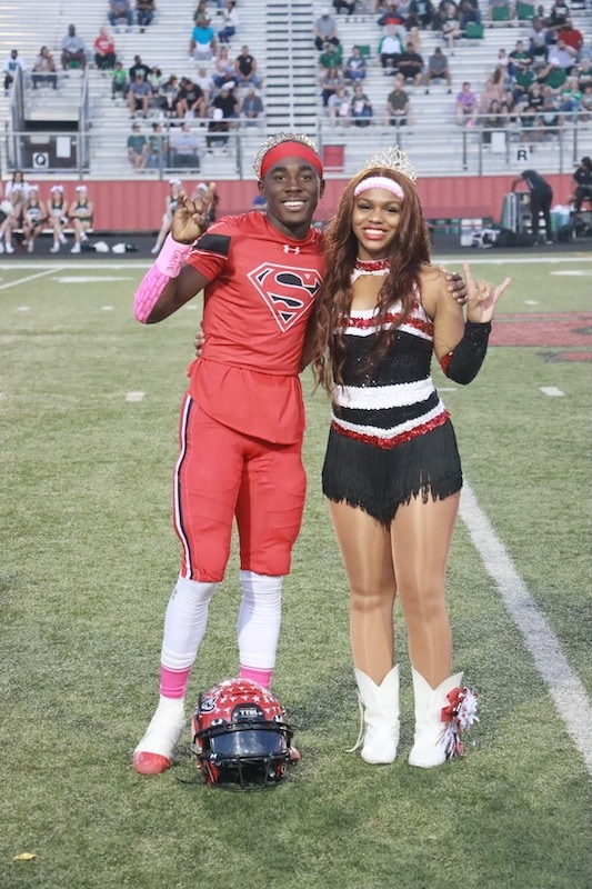 Ch football player with cheerleader