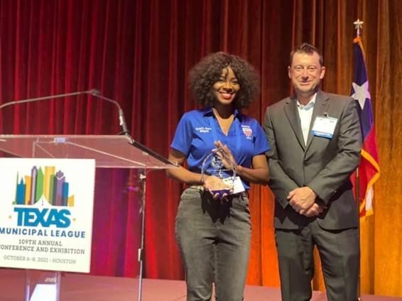 Mayor Proctor holding award