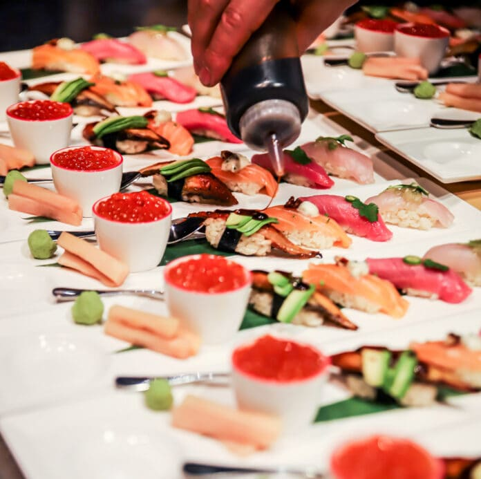 salmon sushi on plates
